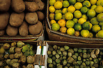 Potatoes, limes, and tomatillos in market, Tijuana, Mexico