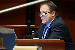 Nevada Assemblyman John Moore, R-Las Vegas, works on the Assembly floor at the Legislative Building in Carson City, Nev., on Tuesday, April 21, 2015. <br /> Photo by Cathleen Allison