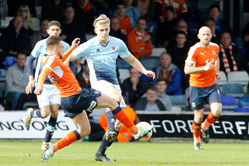 Blackpool's Brad Potts battles with Luton Town's Lawson D'Ath<br /> <br /> Photographer David Shipman/CameraSport<br /> <br /> The EFL Sky Bet League Two - Luton Town v Blackpool - Saturday 1st April 2017 - Kenilworth Road - Luton<br /> <br /> World Copyright &copy; 2017 CameraSport. All rights reserved. 43 Linden Ave. Countesthorpe. Leicester. England. LE8 5PG - Tel: +44 (0) 116 277 4147 - admin@camerasport.com - www.camerasport.com