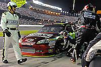 Jeff Gordon (#24) makes a pit stop.