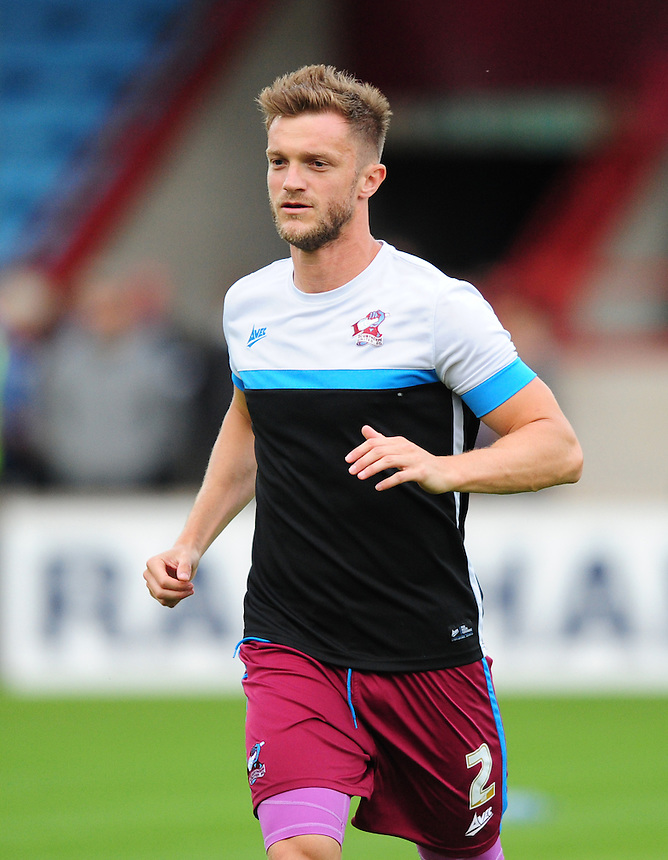 Scunthorpe United's Scott Wiseman during the pre-match warm-up <br /> <br /> Photographer Chris Vaughan/CameraSport<br /> <br /> Football - Capital One Cup First Round - Scunthorpe United v Barnsley - Tuesday 11th August 2015 - Glanford Park - Scunthorpe<br />  <br /> &copy; CameraSport - 43 Linden Ave. Countesthorpe. Leicester. England. LE8 5PG - Tel: +44 (0) 116 277 4147 - admin@camerasport.com - www.camerasport.com