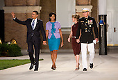 Washington, DC - July 24, 2009 -- United States President Barack Obama, left, First Lady Michelle Obama, center left, and Marine Commandant General James T. Conway, right, and Mrs. Conway, center right, arrive at the Evening Parade at the Washington Marine Barracks on Friday, July 24, 2009.  .Credit: Kristoffer Tripplaar / Pool via CNP