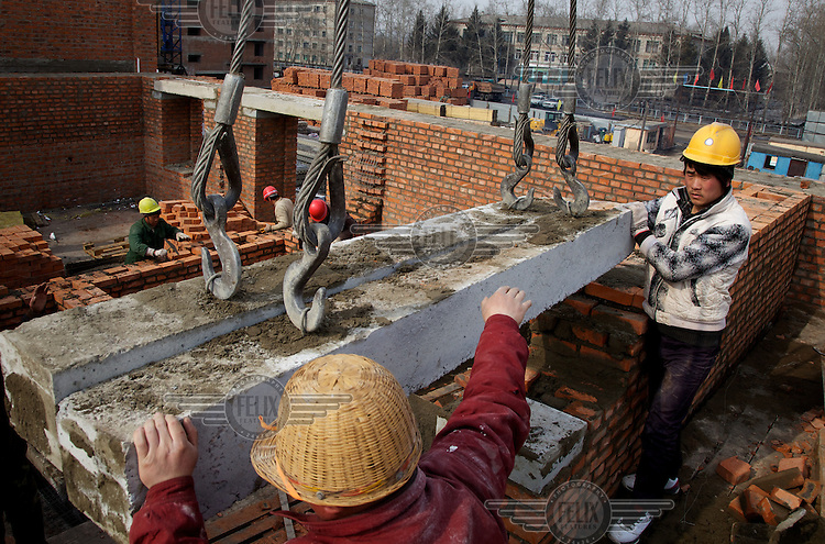 Chinese construction workers build a house in the Russian city of Blagoveshchensk, just across the border from China. Much of the new buildings in Blagoveshchensk, and all over the Russian Far East, is built by Chinese labour who are deemed cheaper and more efficient. This building site is developed by Chinese entrepreneur Li Lihua.