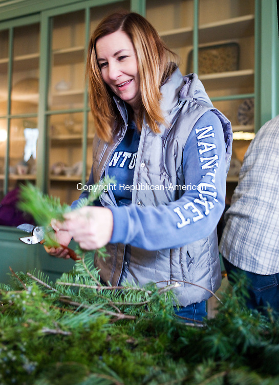 Bethlehem, CT- 28 November 2015-112815CM03-  Nancy D'Agostino of Watertown makes a wreath during a workshop at the Bellamy-Ferriday House in Bethlehem on Saturday. Approximately 20 people attended the event which was put on by horticulturists George and Carol McCleary.  Another workshop will be held on Tuesday December 1st, from 7 p.m. until 9 p.m. The cost is $25 per wreath per family or individual, including materials and admission to the house, and $20 for Connecticut Landmarks members. Pre-registration is required.  To register call the Bellamy-Ferriday House at 203-2667596, or send an email to bellamy.ferriday@ctlandmarks.org.   Christopher Massa Republican-American