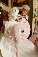 """BNPS.co.uk (01202 558833)<br /> Pic: ZacharyCulpin/BNPS<br /> <br /> Denise uses different varieties of paper to create the dresses.<br /> <br /> Ori-garments -  Artist Denise Watson has created a stunning 1750's masquerade Christmas Ball with characters made entirely from paper at the National Trust's Uppark House in West Sussex.<br /> <br /> Denise has dressed 14 shop mannequins with clothes, shoes, masks, fans, floral details, hair and even jewellery made from things like tissue paper, gift wrap and brown parcel paper. <br /> <br /> The festive display was inspired by Admiral Lord Gambier's memoirs in which he quotes from Lady Sarah Featherstonhaugh's journal of 1753 where she wrote: """" The whole party afterwards proceed to Uppark, where they passed a cheerful happy Christmas in the most friendly society, and enlivened their neighbourhood with some masked balls.""""<br />  <br /> The design to the finished result took a total of three months. Denise said, """"I am really delighted with the final result. It has been a joy to work at Uppark using the grand rooms and to recreate an event which actually took place""""."""