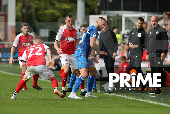 Aaron Wilbraham of Rochdale AFC challenges for the ball with Ashley Hunter of Fleetwood Town during the Sky Bet League 1 match between Fleetwood Town and Rochdale at Highbury Stadium, Fleetwood, England on 18 August 2018. Photo by Stephen Gaunt / PRiME Media Images.