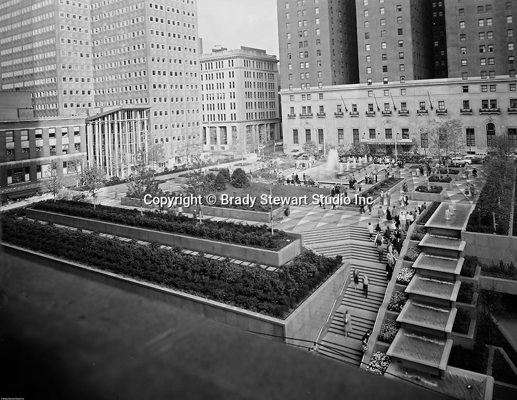 Pittsburgh PA:  View of Mellon Square Park in Pittsburgh - 1959.  Mellon Square, built in 1953-55 was designed by Mitchell & Ritchey, landscaped by Simonds & Simonds, and paid for by Mellon family foundations.  Rumor has it that the park was built to keep Alcoa Corporation from moving from Pittsburgh to New York City in the early 1950s.  Other building in the photo include:  William Penn Hotel and the Alcoa Building.