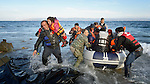 When he landed on the Greek island of Lesbos on October 30, 2015, Nabil Minas, a refugee from Syria, carried his children through the water--including the daughter he carries on the left--and left them on the shore, then fell on his face and kissed the ground. A Christian, he crossed himself and covered his face with his hands, weeping with joy. Minas and his family came in the boat from Turkey, paying an exorbitant amount to traffickers who provided the transport.