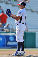 Tennessee Smokies starting pitcher Yoanner Negrin #9 delivers a pitch during a game against the Huntsville Stars at Smokies Park on August 12, 2012 in Kodak, Tennessee. The Smokies defeated the Stars 4-0. (Tony Farlow/Four Seam Images).