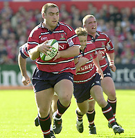 Photo Peter Spurrier.12/10/2002.Heineken European Cup Rugby.Gloucester vs Munster - Kingsholm.Gloucester front row.Gloucester's Trevor Woodman. breaks with support and the ball.