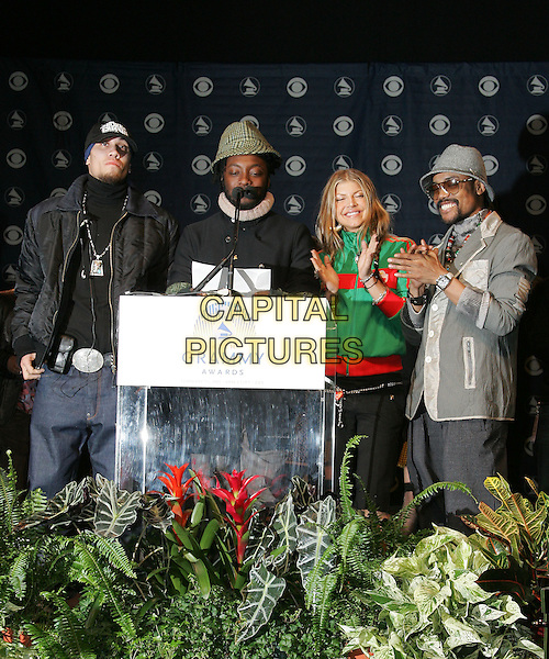 BLACK EYED PEAS - TABOO, WILL.I.AM, FERGIE & APL.DE.AP..The 47th Annual Grammy Award Nominees Announcements. The announcement were held at The Music Box in Hollywood, California .December 7th, 2004.full length, hats, clapping, speech, public speaking, podium.www.capitalpictures.com.sales@capitalpictures.com.Supplied By Capital PIctures