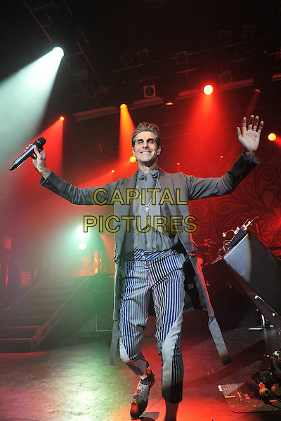 Perry Farrell.Jane's Addiction performing live at Koko, London, England..August 30th, 2011.stage concert live gig performance music full length blue grey gray black pinstripe trousers shirt hands arms jacket.CAP/MAR.© Martin Harris/Capital Pictures.