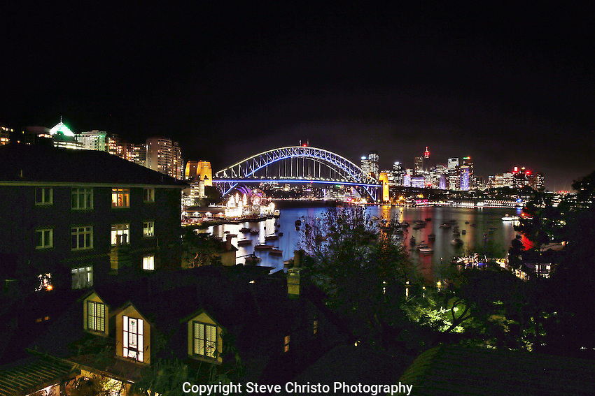 Vivid Sydney: A Festival of Light, Music and ideas on the foreshore of Sydney Harbour. For the first time, the western side of the Sydney Harbour Bridge is lit up. As a world-first feat the public controls the interactive lighting. Sydney, Australia. Wednesday 2nd June 2013. Photo:( Steve Christo).