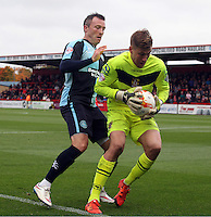 Garry Thompson of Wycombe Wanderers and Jesse Joronen of Stevenage in action during the Sky Bet League 2 match between Stevenage and Wycombe Wanderers at the Lamex Stadium, Stevenage, England on 17 October 2015. Photo by PRiME Media Images.