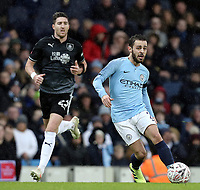 Manchester City's Bernardo Silva under pressure from Burnley's Stephen Ward<br /> <br /> Photographer Rich Linley/CameraSport<br /> <br /> Emirates FA Cup Fourth Round - Manchester City v Burnley - Saturday 26th January 2019 - The Etihad - Manchester<br />  <br /> World Copyright © 2019 CameraSport. All rights reserved. 43 Linden Ave. Countesthorpe. Leicester. England. LE8 5PG - Tel: +44 (0) 116 277 4147 - admin@camerasport.com - www.camerasport.com