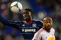 Jalil Anibaba (6) of the Chicago Fire and Thierry Henry (14) of the New York Red Bulls battle for the ball. The New York Red Bulls defeated the Chicago Fire 5-2 during a Major League Soccer (MLS) match at Red Bull Arena in Harrison, NJ, on October 27, 2013.