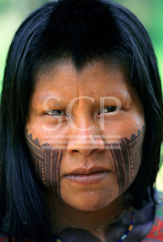 A-Ukre Village, Xingu, Brazil. A Kayapo woman with intricate black Genipapo face paint.   Payakan's wife.