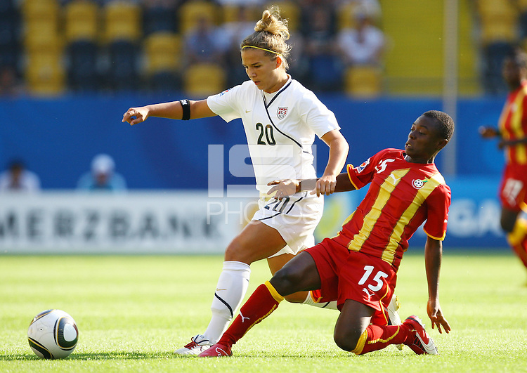 USA's Amber Brooks (L) and Juliet Acheampong of Ghana during the FIFA U20 Women World Cup at the Rudolf Harbig Stadium in Dresden, Germany on July 14th, 2010.
