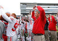 "Ohio State Buckeyes head coach Urban Meyer sings ""Carmen Ohio"" following the team's 56-0 win over Purdue during the NCAA football game at Ross-Ade Stadium in West Lafayette, Ind. on Nov. 2, 2013. (Adam Cairns / The Columbus Dispatch)"