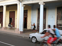 Baseball with a stick on the prado in Cienfuegos, Cuba -Photo by Meryl Schenker