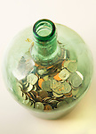 Jar of coins on white background.