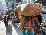 Carrying goods between the Indo-Burmese border and Mizoram's capital Aizawl - Chin refugees often work as porters