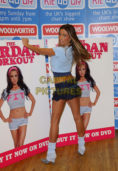 JORDAN - KATIE PRICE.DVD Signing & Trolley Dash at Woolworths, Lakeside Shopping Centre, West Thurrock, Essex, UK..January 5th, 2006.Ref: FIN.full length leg warmers looking over shoulder skirt blue ruffles.www.capitalpictures.com.sales@capitalpictures.com.© Capital Pictures.