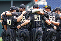 Vanderbilt Commodores pregame huddle before Game 8 of the NCAA College World Series against the Mississippi State Bulldogs on June 19, 2019 at TD Ameritrade Park in Omaha, Nebraska. Vanderbilt defeated Mississippi State 6-3. (Andrew Woolley/Four Seam Images)