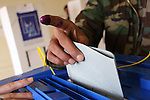 ERBIL, IRAQ: A Kurdish Peshmerga soldier votes in the Ahmedi Khani school in Erbil...Three days before the polls open, military and convicts vote in the Iraqi Parliamentary Elections...Photo by Rafiq Tekin/Metrography