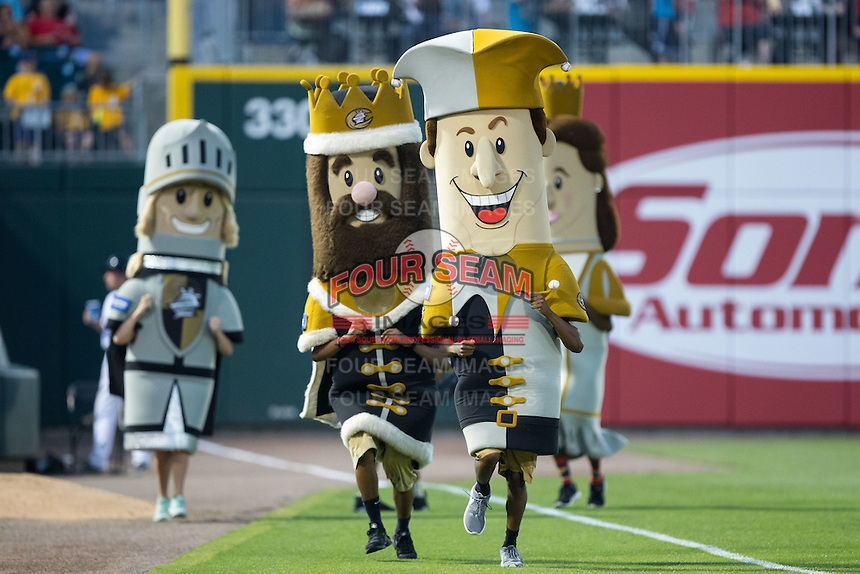 Jerry the Jester tries to run away from King Mecklenburg, Queen Charlotte, and Good Knight Charlie during the Royalty Race between innings of the International League game between the Lehigh Valley Iron Pigs and the Charlotte Knights at BB&T BallPark on June 3, 2016 in Charlotte, North Carolina.  The Iron Pigs defeated the Knights 6-4.  (Brian Westerholt/Four Seam Images)