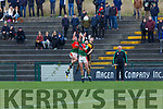 Noel Duggan and Dan Moynihan Kilcummin rises with Brian Looney Dr Crokes during their East Kerry clash in Killarney on Saturday