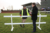 A trestle is employed to block off the fence by the finish line which was jumped by mistake at the last meeting - Horse Racing at Fakenham Racecourse, Norfolk