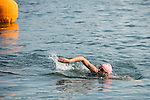 Triathlete swimming toward the second step, in Baie Saint-François.