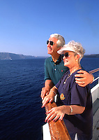 Retired couple enjoying view from cruise ship deck