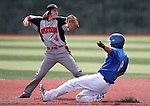 Colorado Northwestern's Jake Morgan puts Western Nevada's Brandon Lapointe out on a double play ball in a college baseball game at John L. Harvey Field in Carson City, Nev., on Friday, April 11, 2014. <br /> Photo by Cathleen Allison/Nevada Photo Source