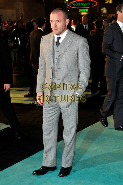 """GUY RITCHIE .Attending the World Premiere of """"Sherlock Holmes"""", Empire cinema Leicester Square, London, England, UK, .December 14th 2009..arrivals full length grey gray wool suit tie hand in pocket waistcoat black shoes .CAP/PL.©Phil Loftus/Capital Pictures."""