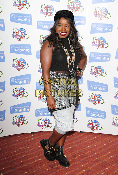 Misha B <br /> at the Girlguiding Big Gig at the LG Arena, Birmingham, England, UK, June 1st 2013.<br /> full length black cap hat smiling gold necklace sleeveless polo neck sheer sheer netting fishnet cropped jeans shorts boots shirt buckles <br /> CAP/JIL<br /> &copy;Jill Mayhew/Capital Pictures