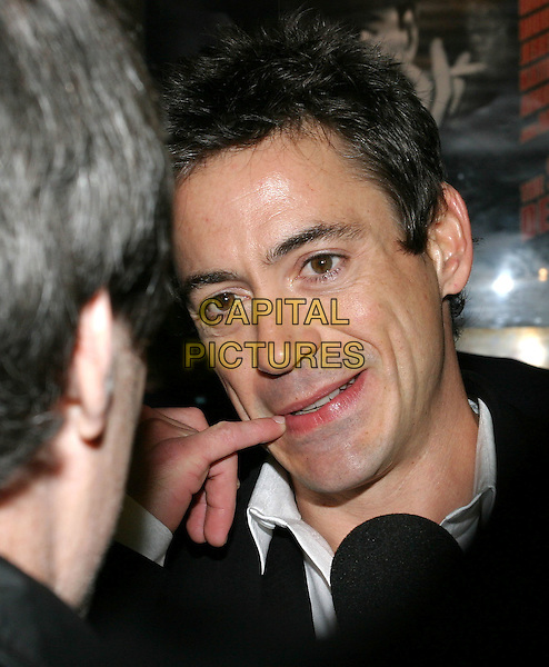 ROBERT DOWNEY JR.The Singing Detective UK Gala Screening, Everyman Cinema.funny face, finger, mouth.www.capitalpictures.com.sales@capitalpictures.com.© Capital Pictures.