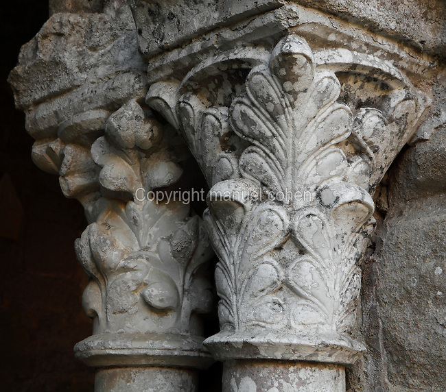 Capitals with foliage carvings from the Cloister of Fontfroide Abbey or l'Abbaye Sainte-Marie de Fontfroide, Narbonne, Languedoc-Roussillon, France. Founded by the Viscount of Narbonne in 1093, Fontfroide linked to the Cistercian order in 1145. These capitals date from the first cloister, built 1180-1210 in Romanesque style, with double columns topped by foliage capitals supporting semicircular arches. The cloister was later altered in the 13th century after the Albigensian Crusade, when tympanums were added and the original wooden roof was replaced with stone. Picture by Manuel Cohen
