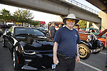 "Bellmore, New York, USA. August 24, 2018. ""Mr. Blowtorch"" stands next to his black Chevrolet SS at Bellmore Friday Night Car Show, in parking lot of LIRR Bellmore station."