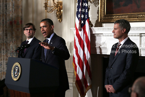 United States President Barack Obama speaks as chairman of the Council of Economic Advisers Alan Krueger (R) and economist Jason Furman listen during a personnel announcement June 10, 2013 at the State Dining Room of the White House in Washington, DC. President Obama has nominated Furman to succeed Krueger as the chairman of the Council of Economic Advisers. <br /> Credit: Alex Wong / Pool via CNP