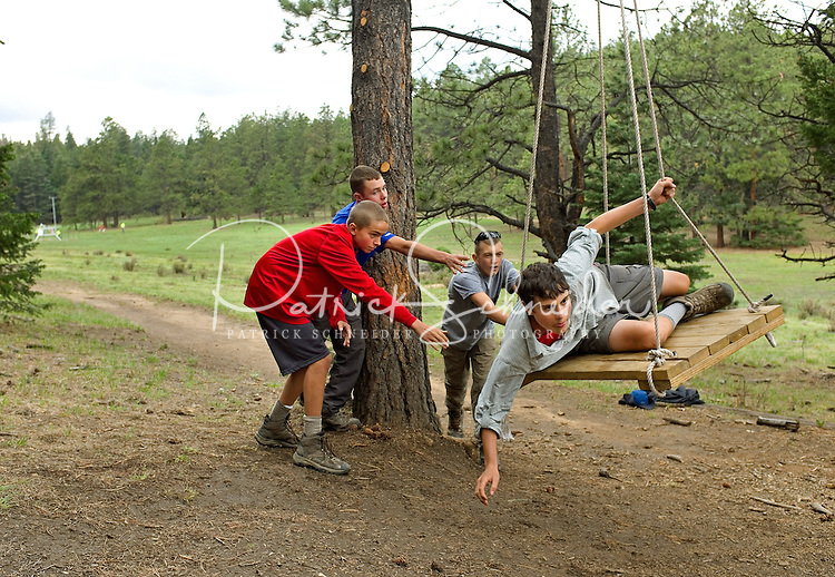 Photo story of Philmont Scout Ranch in Cimarron, New Mexico, taken during a Boy Scout Troop backpack trip in the summer of 2013. Photo is part of a comprehensive picture package which shows in-depth photography of a BSA Ventures crew on a trek. This photo show BSA Venture Crew members working together through the Philmont COPES Course program in the backcountry of the Philmont Scout Ranch.<br /> <br /> The  Photo by travel photograph: PatrickschneiderPhoto.com