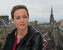 Kath M Mainland, Chief Executive of the Edinburgh Festival Fringe Society, on the roof of St Giles' Cathedral, overlooking the Royal Mile, busy with Fringe activity, during the Edinburgh Festival Fringe.
