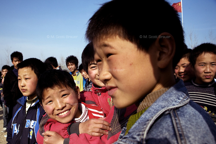 Students gather outside for recess at an elementary school in rural Jiangsu Province, China.