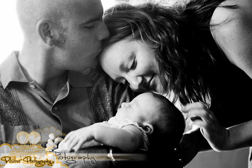 Heather Haroldson, Eric Haroldson and their newborn Tori Haroldson, 4 mos, on Saturday, October 2, 2010, at their home in Daytona Beach, Florida. (Chad Pilster, PilsterPhotography.net)