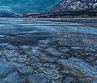 Fine Art Winter Scenic of Ice bubbles forming on Vaseux Lake as winter is approaching and the lake is freezing over. BC, Canada.