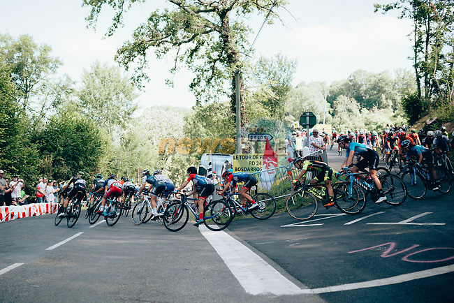 The peloton in action during La Course 2019 By Le Tour running 121km from Pau to Pau, France. 19th July 2019.<br /> Picture: ASO/Thomas Maheux   Cyclefile<br /> All photos usage must carry mandatory copyright credit (© Cyclefile   ASO/Thomas Maheux)