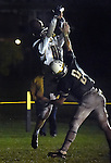 (Lexington MA 10/28/16) Andover 88, Cedric Gillette, takes this pass off his helmet in the end zone, blocked by Lexington 9, Sal Frelick, tries to catch him, during the first half, Friday, Oct 28, 2016, at Lexington High School. (Jim Michaud / Journal Inquirer)