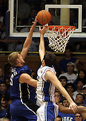 "Mason Plumlee (5) shoots over Ryan Kelly (34). Duke men's basketball had an opening scrimmage game as a part of the ""Countdown to Craziness"" event at Cameron Indoor Stadium Friday Oct. 14, 2011.  Photo by Al Drago..."