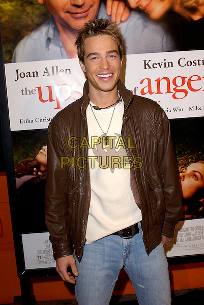 RYAN CARNES.Attends New Line Cinema's World Premiere of Upside of Anger held at the Mann National Theatre in Westwood, California  .March 3rd 2005.half length brown leather jacket.www.capitalpictures.com.sales@capitalpictures.com.Supplied By Capital PIctures
